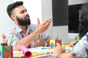 A teacher helping a student study by having a dialogue